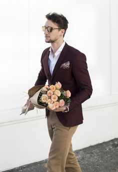 Your prince charming is here. Men's style. Man with flowers.