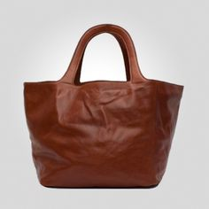 Millie: Perfection in a tote. Top handles. open bucket and pocket at the bottom for all of your treasures. Soft everyday bag - delicious waxy otalian calf skin, unlined, raw suede inside with an open view to all of your goodies. $342