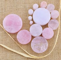 Rose Quartz is a form of quartz with possible colors of white, pink, red, and clear stone with layered banding or a swirl/cloudy mixture. The color variations come from trace amounts of titanium, iron