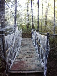 """Bridge for Halloween yard haunt, spider webs all around it. Build a solid structure with no give in the walkway. then cover with 1"""" foam from the local fabric store. Cover the foam cushion with your catwalk slats..."""