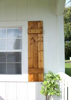 This is that easy front yard update that will make your neighbors stare wood shutters exterior curb appeal Impress Your Neighbors with DIY Shutters Pallet Shutters, Outdoor Shutters, Cedar Shutters, Wooden Shutters Exterior, Farmhouse Shutters, Outside Window Shutters, Home Shutters, Wooden Window Shutters, Wooden Doors