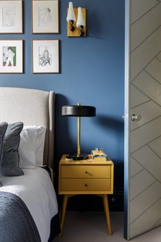 Bold blue walls with yellow side table. Interior by Gunter & Co. Navy Yellow Bedrooms, Blue Bedroom, Navy Bedroom Decor, Yellow Bedroom Furniture, Bedroom Ideas, Yellow Side Table, Mustard Bedroom, Mustard Yellow Decor, Floor To Ceiling Cabinets