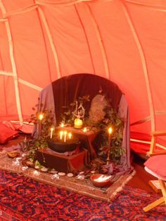 Miriam's Earth Altar. Quest/Altar. In women's Red Tent with unique back board and levels, draped, plus tapestry floor cover.