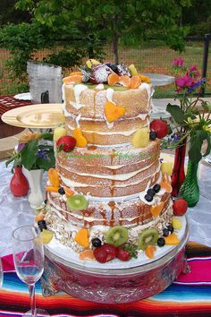 Pennington's Cakes - San Marcos Cakes - A three-tiered naked wedding cake with fresh fruit and powdered sugar