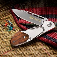"""Beretta Gentleman's Pocket Knife legendary for their quality, reliability, precision, and sheer beauty of design. Beretta trident ranks as one of the world's most recognized, and respected, logos. Our Gentleman's Pocket Knife uses a classic liner-lock mechanism for absolute safety in use. Skeletonized blade spine permits one-handed opening. Fine-edged, 2.75"""" blade is forged from 440c — a high alloy, high-carbon stainless steel hardened to 56-58Rc for superior sharpness and edge retention."""