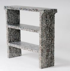 Designed by Belgian industrial designer Jens Praet these sleek and textured furniture pieces are constructed from shredded magazines and documents mixed with clear resin.