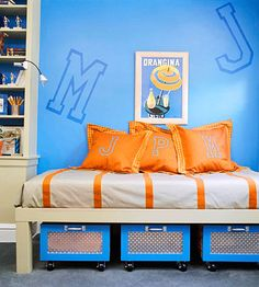 Heavy Metal - A custom-made alder platform bed fits snugly between bookshelves and a window and allows room for under-bed storage in this energetic boy's room. The duvet is sewn from khaki twill with top stitched decorative 2-inch stripes. Orange twill shams sport plaid-flannel flanges and initials applied with fabric paint.