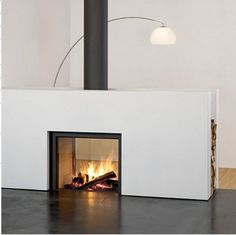 NOTE: Modern double sided wood burning stove/fireplace combination with wood storage stuv 21 fireplace2