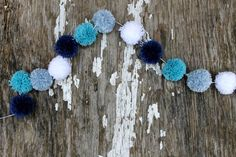 Blue and White Christmas Yarn Pom Pom Garland  - pom poms, garlands, nursery decor, Christmas Decor, Hanukkah, Buntings and Photo Props by CupcakeWishesStore on Etsy https://www.etsy.com/listing/211830407/blue-and-white-christmas-yarn-pom-pom