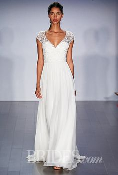 A flowing @jlmcouture gown with short sleeves | Brides.com