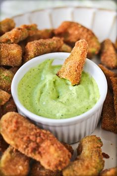 Avacado Fries with Cilantro Lemon Dipping Sauce  -----------------  Avocado Fries  ---------------  Oil For Frying  2 Avocados  2 Eggs, beaten  1 and 1/3 Cup Bread Crumbs  1 Teaspoon Lemon Pepper  1/2 Teaspoon Salt  1/4 Teaspoon Cumin  ---------------------------  Cilantro Lemon Dipping Sauce  ----------------------------------  5 Tablespoons Mayonnaise  3 Tablespoons Fresh Cilantro, chopped  Juice from 1/2 of Lemon