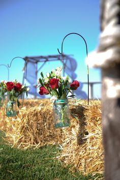 Mason jar vase hung with dollar tree hooks lined the isle. Bales of straw for seats. It was a lovely day :) Wedding Pins, Rose Wedding, Dream Wedding, Mason Jar Vases, Mason Jar Centerpieces, Wedding Seating, Rustic Wedding, Wedding Isles, Joshua Tree Wedding