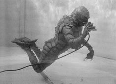 """Ricou Browning, """"the underwater Creature"""", getting some air from a hose in between takes."""