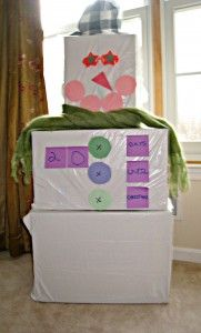 Snowman advent calendar made from shipping boxes and white garbage bags. Easy and cute! #pinspirationparty!