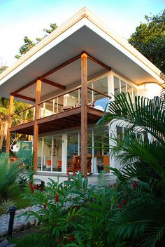 The White House, Santa Teresa Costa Rica- this is a great example of the house being built to match its surrounding. It is airy and beachy while still feeling modern!