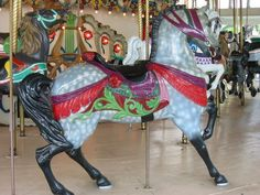 1909 Dentzel Carousel Memphis Grand Carousel 3 rows, Park, All Wood composition 32 Jumping Horses, 16 Standing Horses, 2 chariots Band Organ: Recorded music Rare all-horse Dentzel platform. Chariots: Griffin & Dragon. OR horses-Cherni. Burned at Chicago & returned to factory. Forest Park, Chicago, IL, 1909 to 1920. Mid-South Fairgrounds, Memphis, TN, 1923 to 1975. Libertyland, Memphis, TN, 1975 to 2005. Storage, 2005 to present.