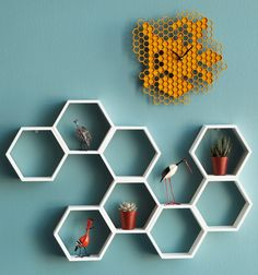 honeycomb shelf  - Sweeten your hive with a sculptural structure any worker bee would be proud of. Beautifully crafted from pine wood, this hand-painted shelf showcases classic honeycomb hexagons sprawling across your wall to hold small trinkets, air plants, and more. Handmade in Austin, TX.    link