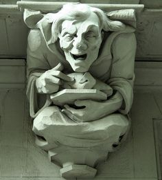 Gargoyle ....man carrying a platter with a roast chicken:  Morningside Heights. The Britannia at 527 West 110th Street. New York