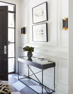 In the foyer, designer Nam Dang-Mitchell mixed limestone and Bianco Carrara marble, cut into parallelograms, to create interest underfoot. | Photo: Colin Way
