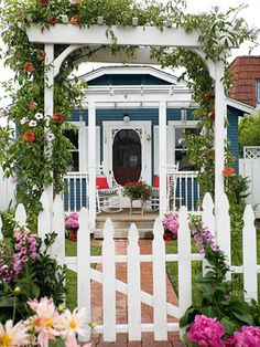 Cottage with white picket fence.. I love everything about this especially the colors.