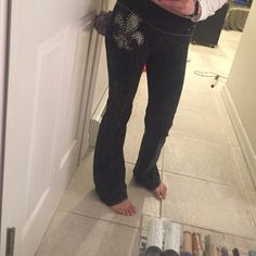 Sexy black/gray stretch pants Awesome condition . Fleur di li emblem on left side T party Jackets & Coats