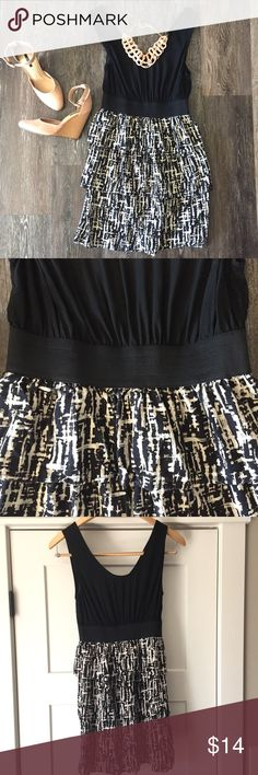 "Black print dress Black and white print dress. Bottom is ruffled/layered. Scoop neck and back. Thick and flattering elastic waste band. Relaxed bust measures 32"". Roughly 34"" long. Perfect condition! Dresses"