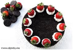 SINFULLY DELICIOUS! A Chocolate Oreo Cake with chocolate buttercream, crushed Oreos and fresh strawberries!