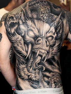 20 Amazing Dragon Tattoo Designs For Men
