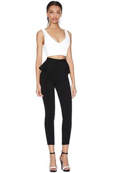 Totally chic black skinny pants featuring a high waist with peplum detailing.