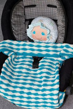 Making Waves Carseat Blanket by Kim Galante. (Doll is not part of pattern.) Free pattern on Ravelry at http://www.ravelry.com/patterns/library/making-waves-carseat-blanket