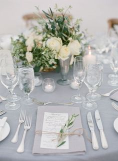 Greenery, cream roses and twine make for an elegant and natural setting.  Photo   Diana McGregor