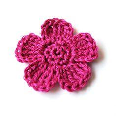 tutorial para hacer esta flor. Se puede hacer el centro amarillo y los pétalos de otro color.