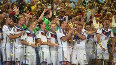 Lukas Podolski of Germany raises the World Cup trophy