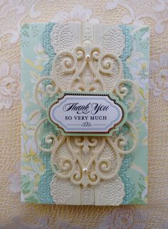 Card by Vickie Blakeslee. Anna Griffin Garden kit card used with Metallic Layers Papers and lace impressions dies and border embossing. Flourish die also used.