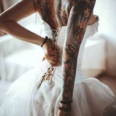 A beautiful tattooed woman in a gorgeous dress is just so sexy!
