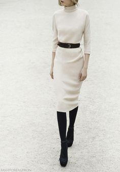Dior; so simple: winter white long-sleeved sheath dress, skinny black belt, black tights & pumps