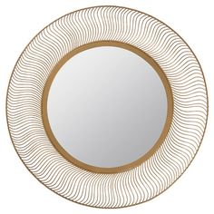 Add a chic touch to your entryway or powder room with this striking wall mirror, showcasing an openwork frame.   Product: Wall m...