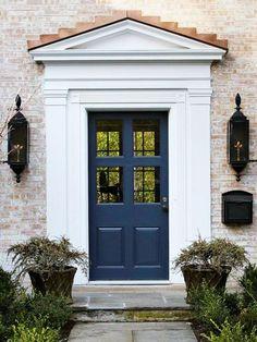 Image result for navy blue door whitewashed brick
