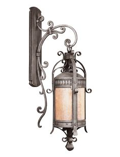 The elaborate iron work on this Chateau sconce adds the perfect flourish to your outdoor space.