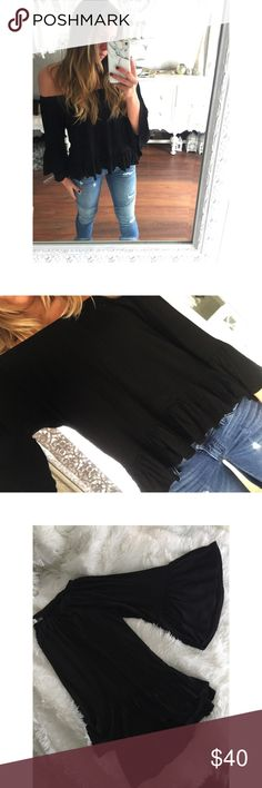 JUST IN || Bella blouse The Bella blouse features an oversized body & off the shoulder silhouette, high to low hem with ruffle detail around body & sleeve. Super soft & casual material, perfect for a girls night out or work party! •Modeling a size small { runs oversized} •95% Rayon 5% Spandex Tops Blouses