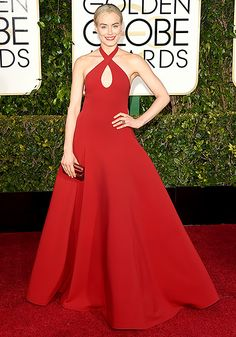 Taylor Schilling The Orange Is the New Black star embodied class in a red Ralph Lauren dress with crisscrossed straps that created a keyhole.  Read more: http://www.usmagazine.com/celebrity-style/pictures/golden-globes-2015-red-carpet-fashion-what-the-stars-wore-2015111/43368#ixzz3OaAyxRah  Follow us: @usweekly on Twitter   usweekly on Facebook