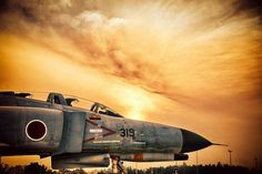 F4 Phantom Fighter Jet  amazing background of the sun behind the clouds