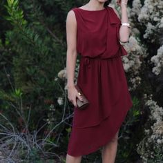 Burgundy Holiday Dress This dress is simply beautiful! Burgundy in color. Chiffon-like fabric. Draped back. Comes in S,M,L. Please indicate size for separate listing. Price is firm. Dresses