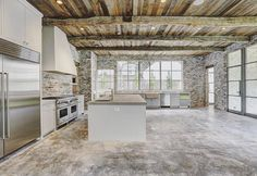 """Stunning #kitchen"" Reclaimed wood beams and wood ceiling. Commercial kitchen appliances. Concrete counters."
