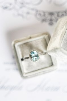 Aquamarine engagement ring. Photography : Brianna Wilbur Read More on SMP: http://www.stylemepretty.com/pennsylvania-weddings/wrightsville-pennsylvania/2016/08/19/navy-backyard-farm-wedding/