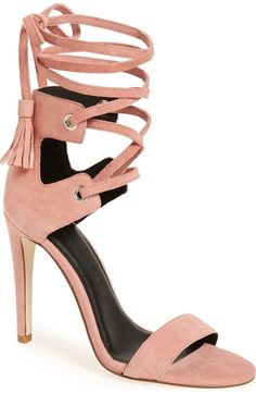 A tassel-embellished wraparound strap is a vintage-chic update to this Rebecca Minkoff stiletto sandal shaped from smooth leather.