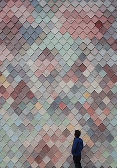 Credit: Assemble Exterior of the Yardhouse clad in multi-coloured concrete tiles made by hand on site