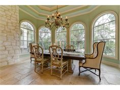 Mint green dining room with mismatched chairs at 601 S Angel Light Dr, Spicewood TX Green Dining Room, Dining Rooms, Beautiful Kitchens, Beautiful Homes, Austin Real Estate, Mismatched Chairs, Limestone Wall, My Dream Home, Dream Homes