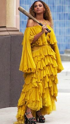 Amal Just Joined a Long and Iconic List of Celebrities in Yellow Dresses 774a86a63