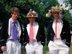 Floral fancy: At Eton, rowers, or wet bobs, in their traditional Stand Naval uniforms worn...